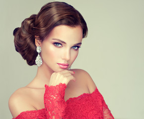 Fototapeta Do fryzjera Beautiful model with elegant hairstyle . Beautiful woman with fashion wedding hairstyle with trend makeup .