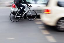 Cyclist In City Traffic
