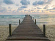 wooden bridge to the sea with twilight sky in the summer time