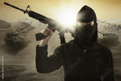 Fotografia, Obraz Terrorist with gun and military vehicle