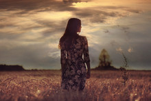 Girl In The Sunset Cloudy Sky Field