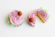 Two Purple Cupcake On A White Background