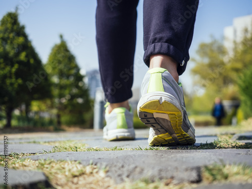Fotografie, Obraz  Woman Walking in Park Outdoor Jogging exercise Healthy Lifestyle