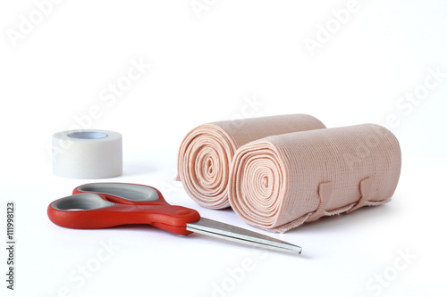 Photo Medical bandage rolls, bandage, elastic , scotch tape, first aid supplies, a white background