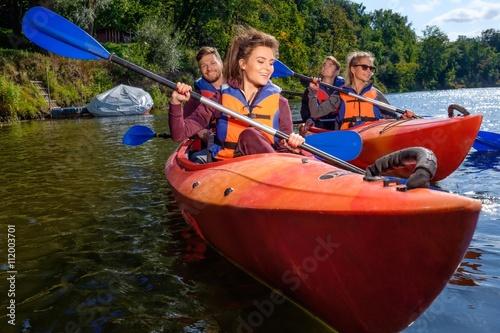Fotografie, Obraz  Happy best friends having fun on a kayaks