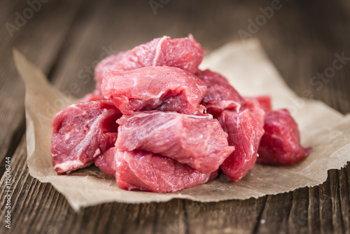 Photo  Beef Fillet (chopped) on wooden background