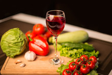 Glass Of Red Wine And Fresh Salad Vegetables