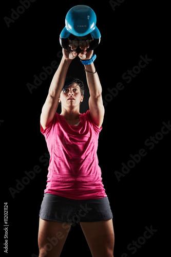 ragazza kettlebell swing - Buy this stock photo and explore similar