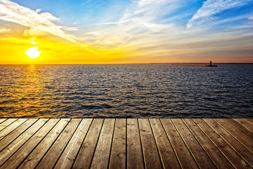 FototapetaSunset background with empty plank and sea.
