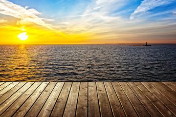 Fototapeta Wschód / zachód słońca Sunset background with empty plank and sea.