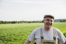 Portrait Of Smiling Farmer At A Field