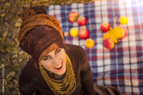 obraz dibond smiling young woman in tribe style