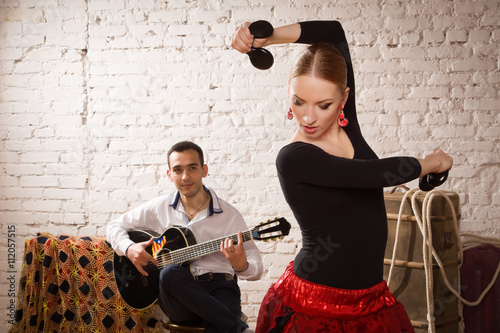 Montage in der Fensternische Karneval Young woman dancing flamenco and a man playing the guitar