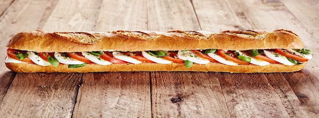 Obraz na SzkleHealthy crusty baguette with mozzarella and tomato
