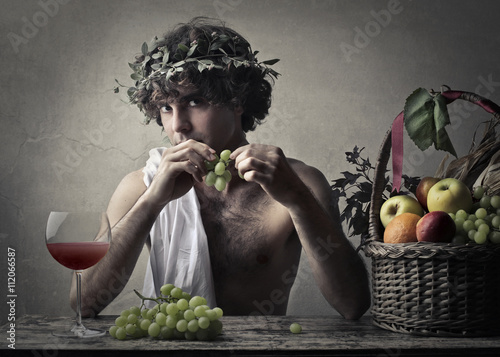 Bacchus holding a bunch of grapes Canvas Print