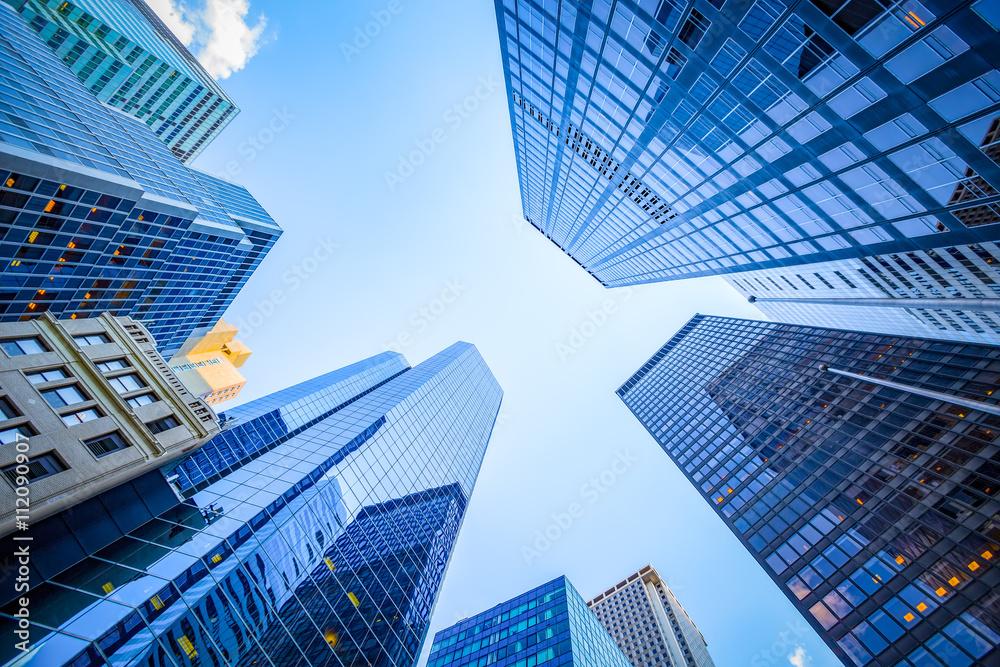 Fototapeta Up view in financial district, Manhattan, New York