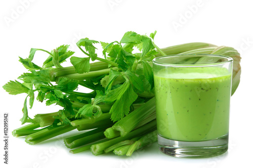 Fresh green celery juice in glass isolated on white background