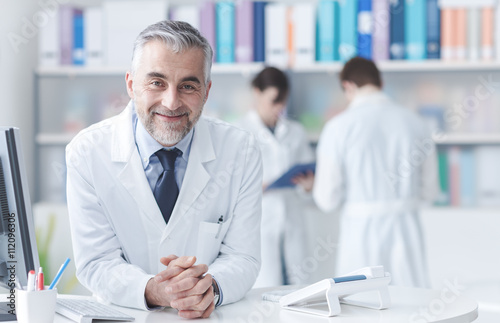 Confident doctor at the reception desk Canvas Print