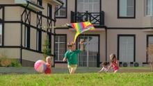 Four Children Running Barefoot...