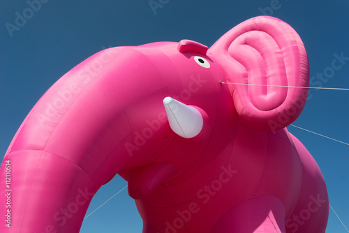 Inflatable pink elephant on a background of blue sky Wallpaper Mural