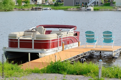 Pontoon Boat Tied to a Dock