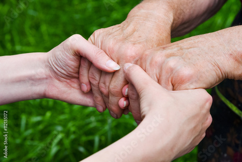 Poster Nature Close up young and elderly hands