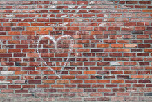 White Chalk Heart On A Red Brick Wall