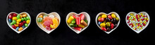 Candy Banner In Heart-shaped Dishes Over Black