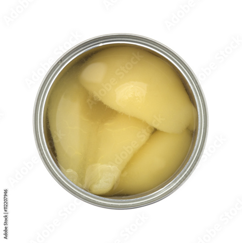 Top view of an opened can of pears halves isolated on a white background
