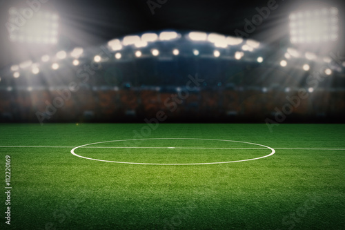Obraz empty football field with stadium at night - fototapety do salonu