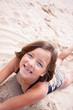 Girl smiling in the sand