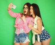 canvas print picture - two stylish sexy hipster girls best friends ready for party