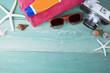 Summer travel beach accessories on wooden board..