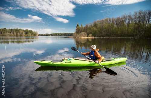 Valokuva  Kayaker on the lake, paddling, active lifestyle