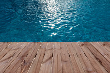 Old Wooden Floor And Blue Water In Swimming Pool