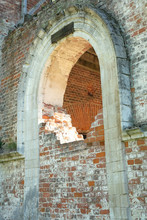 Arch, Partially Laid Bricks In The Wall Of Old Destroyed Christian Church
