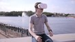 Young Man wearing virtual reality goggles outdoor. HD.