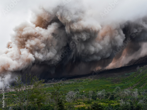 Photo sur Toile Volcan Thick smoke and ash from the volcano Sinabung is spread along the side of the mountain (Sumatra, Indonesia)