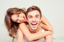 Cheerful Smiling Couple In Love Hugging In The Bedroom