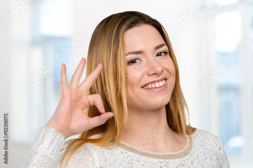 Valokuva  Lovely woman showing ok sign