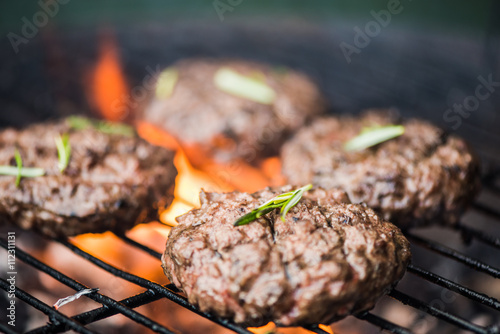 Tuinposter Grill / Barbecue bbq burgers, smoke and fire