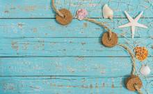 Fishing Net Seashells And Starfish On Turquoise Blue Wood