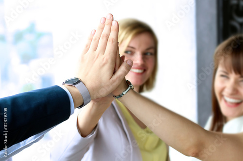 Photographie  happy business team giving high five in office