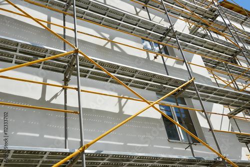 Obraz na plátně scaffolding near a house under construction for external plaster works, high apa