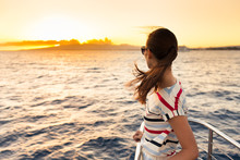 Young Woman Watching The Sunse...