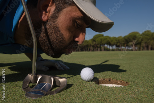 Fotografie, Obraz  golf player blowing ball in hole