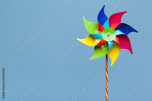 Fotografia, Obraz  Colorful pinwheel isolated on blue background
