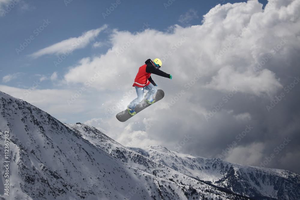 Fotografie, Tablou  Snowboard rider jumping on mountains