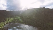 Aerial Of Hawaii Rainforest Valley With Sunrays And Mountains On Molokai
