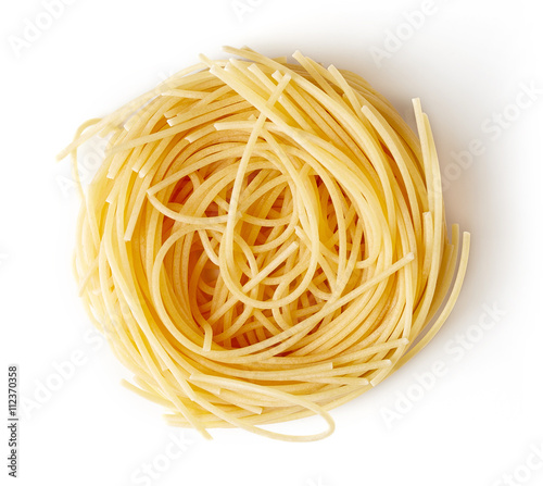 Fotografia Pasta nest isolated on white, from above
